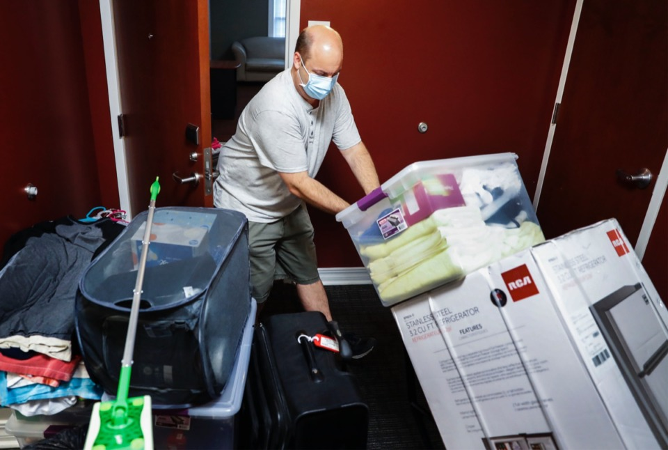 <strong>Christian Brothers University parent Mike Bowen hauls his daughter Jessica&rsquo;s (not pictured) dorm room supplies during freshman move-in day on Tuesday, August 11, 2020.</strong> (Mark Weber/Daily Memphian)