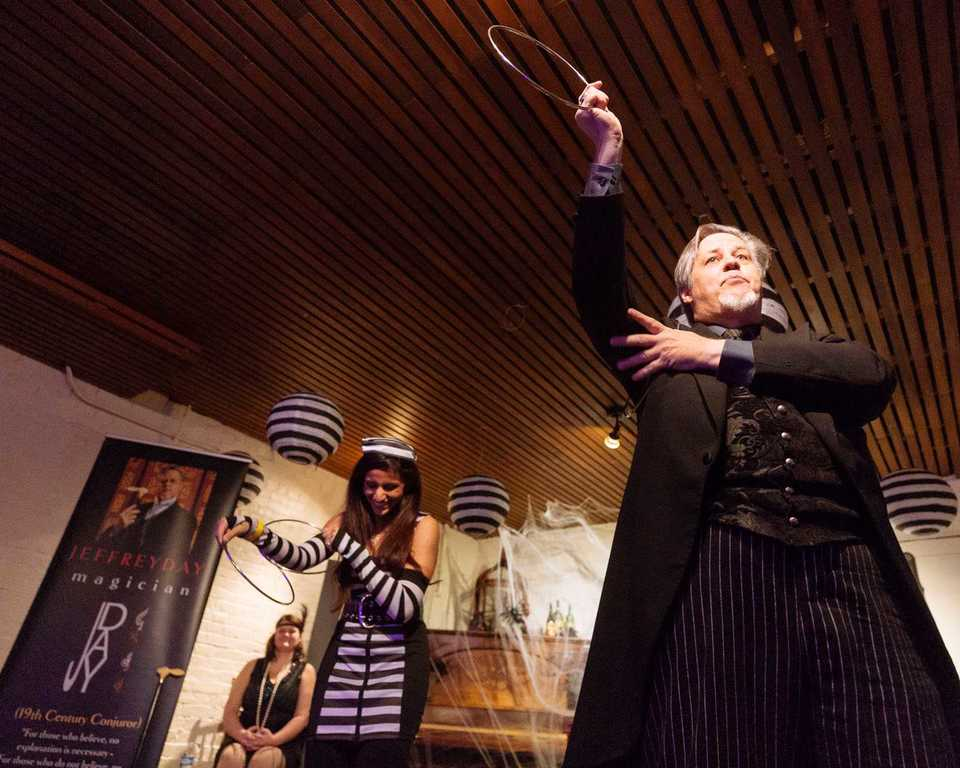 <strong>Magician Jeff Day along with audience participant Nausheen Bhagat playfully shows audience that the tricks are harder than they seem at the Woodruff Fontaine House Haunted Happenings event this fall.</strong> (Ziggy Mack/Daily Memphian)