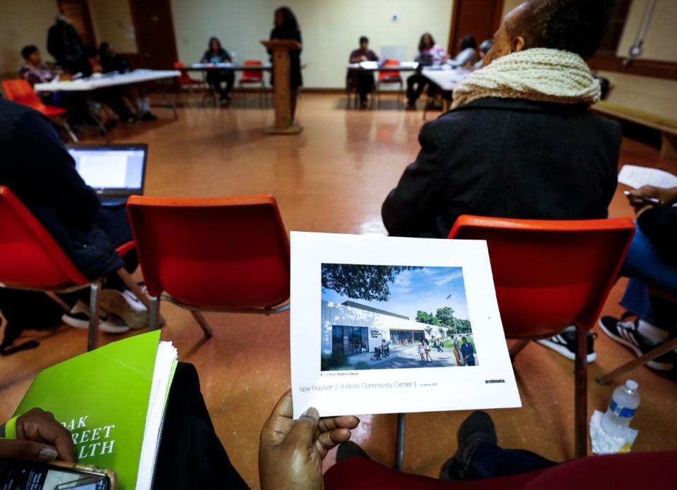 <strong>Renderings of the new Ed Rice Community Center are passed around during a Frayser Community Association meeting Monday, Feb. 17, 2020 at Word of Life Church</strong>. (Mark Weber/Daily Memphian)