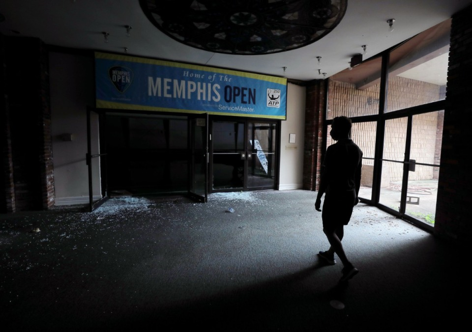<strong>Matt Uselton walks through the halls of the Racquet Club on Aug. 14, 2020, as he gives one last tour before it is&nbsp;demolished. The property has been empty since 2019.</strong> (Patrick Lantrip/Daily Memphian)