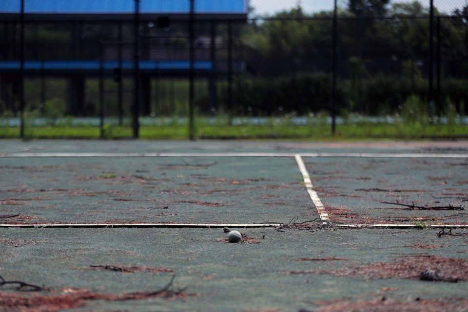 <strong>A weathered, old tennis ball sits outside of the Racquet Club echoing back to a time when the East Memphis courts were full.</strong> (Patrick Lantrip/Daily Memphian)
