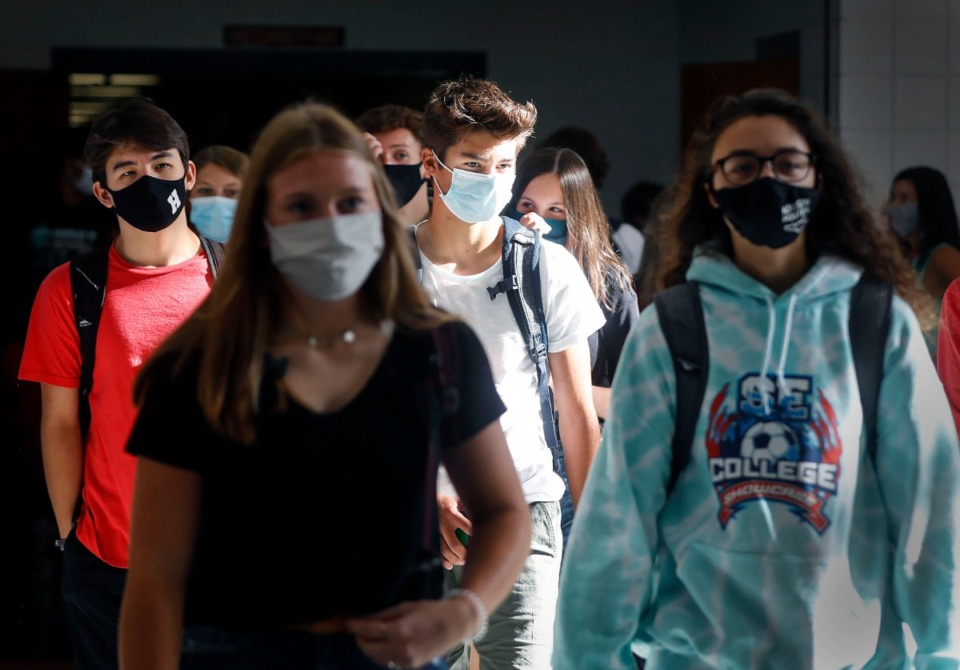 <strong>Houston High School students walk to their second period classes on the first day of school Monday, August 17, 2020. There are nearly 2,000 students who attend the high school, but due to COVID-19 guidelines, there will be only be about 700 in the building on any given day. On Fridays all students will take part in virtual learning</strong>. (Mark Weber/Daily Memphian)