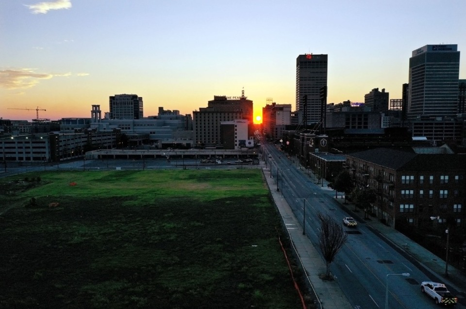 <strong>The sun sets over Union Avenue in Downtown Memphis Aug. 5, 2020, near where The Walk, a billion-dollar mixed-use project formerly known as Union Row, will soon arise.</strong> (Patrick Lantrip/ Daily Memphian)