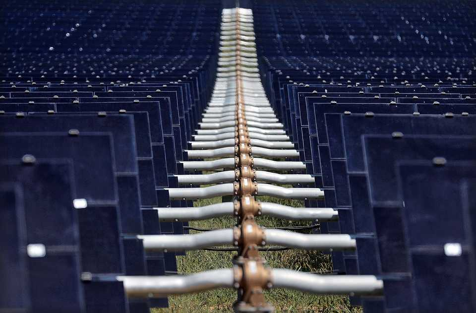 <strong>Small motors control the tilt of the solar panel banks at the new 421 acre solar farm under construction east of Millington on Sept. 18, 2018. Billed as the largest solar farm in the state with over a half million panels, the Silicon Ranch facility is the kind of new business Millington is looking to draw as it tries to leverage its airport and other new retail properties to lead it away from the years as a pit stop for young sailors and toward more higher paying jobs.</strong> (Jim Weber/Daily Memphian)