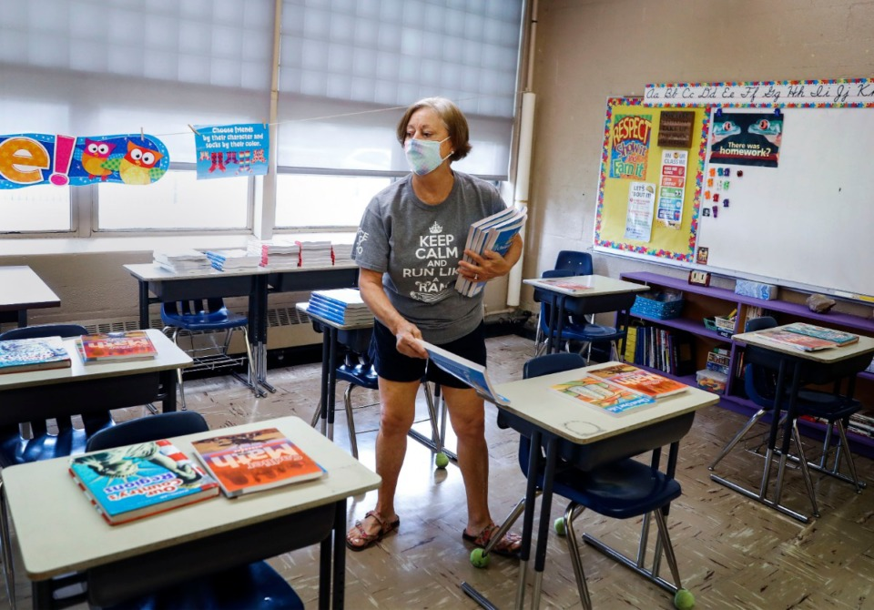 <strong>Nora McGowan, a teacher at Holy Rosary, readied her classroom on Wednesday, July 29, 2020.</strong> (Mark Weber/Daily Memphian file)