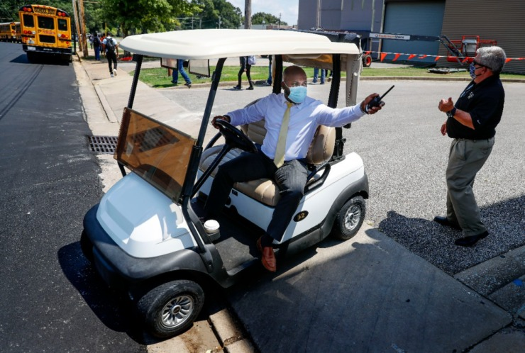 <strong>Millington High School principal Mark Neal (middle) uses a golf cart to get around campus after the first day of classes on Monday, August 10, 2020.</strong> (Mark Weber/Daily Memphian)