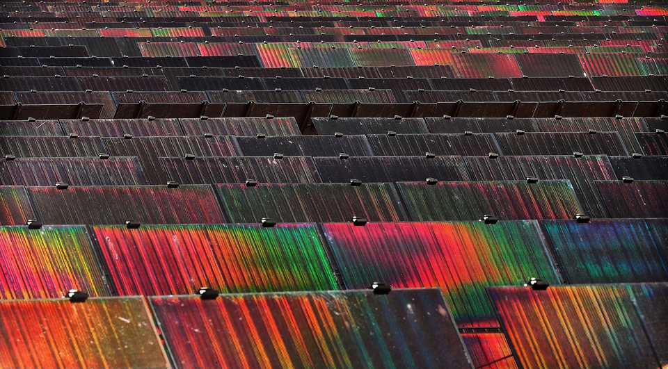 <strong>Midday light strikes rainbows off the panels at the new 421 acre solar farm under construction east of Millington on Sept. 18, 2018. Billed as the largest solar farm in the state with over a half million panels, the Silicon Ranch facility is the kind of new business Millington is looking to draw as it tries to leverage its airport and other new retail properties to lead it away from the years as a pit stop for young sailors and toward more higher paying jobs.&nbsp;</strong>(Jim Weber/Daily Memphian)