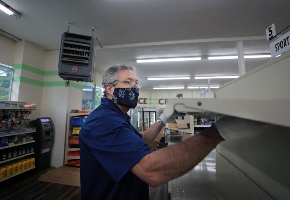 <strong>Steven Lane installs a shelf while remodeling High Point Grocery Aug. 14, 2020.&nbsp;</strong>(Patrick Lantrip/Daily Memphian)