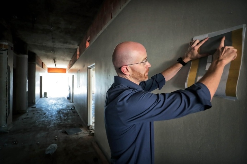 <strong>Adam Underwood goes over a site map for the renovation of the vacant office building at 3637 Park on Oct. 2, 2019. Water to Wine LLC received a Residential PILOT for the planned revival and conversion of the blighted, long-vacant office building.</strong> (Jim Weber/Daily Memphian)