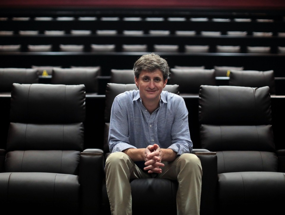 <strong>Malco Theatres president and chief operating officer David Tashie sits in one of the remodeled auditoriums at Malco Paradiso Cinema on Thursday, Aug. 19.&nbsp;&ldquo;We feel like people want to get back out of the house, and they&rsquo;ve always liked to get out of the house and go to movies,&rdquo; said Tashie.</strong> (Patrick Lantrip/Daily Memphian)