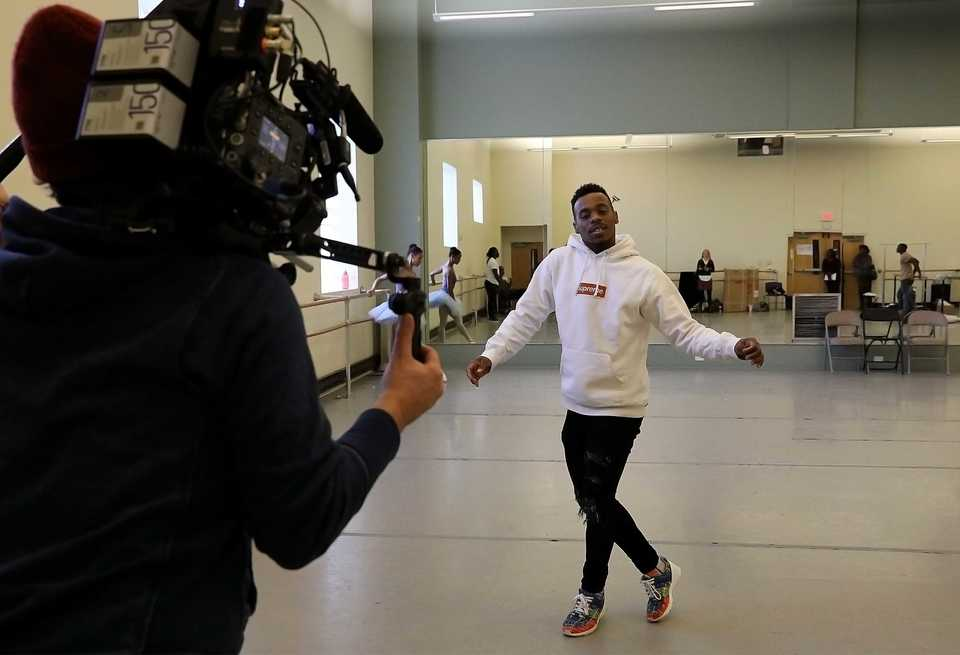 "<strong>Charles ""Lil Buck"" Riley rehearses on Monday, Dec. 10, 2018, at New Ballet Ensemble & School for this year's edition of ""Nut ReMix,"" while two documentarians film him for an upcoming television dance docuseries.</strong> (Patrick Lantrip/Daily Memphian)"