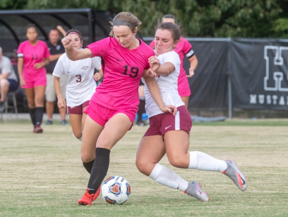 <strong>Houston High's Emma Riales (19) battles with ECS's Maddie Halford (17) for the ball during the season opener at Houston Middle School Thursday, August 20, 2020.</strong> (Greg Campbell/Special to The Daily Memphian)