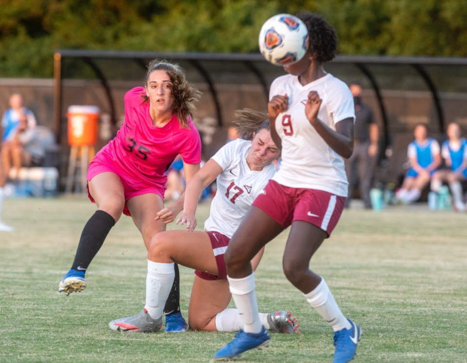 <strong>ECS's Maddie Halford (17) and Grace Evans (8) scramble for the ball with Houston's Chloe Notowich (35) during the season opener at Houston Middle School, Thursday, August 20, 2020.</strong> (Greg Campbell/Special to The Daily Memphian)