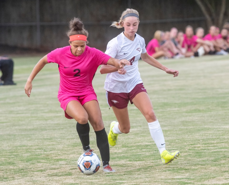<strong>Houston's Kristin Monk (2) charges upfield as ECS's Price Gore (4) pursues during the season opener at Houston Middle School Thursday, August 20, 2020.</strong> (Greg Campbell/Special to The Daily Memphian)