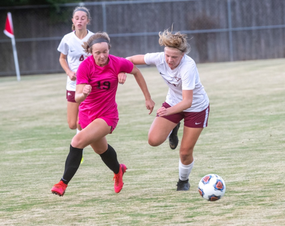 <strong>ECS's CeCe Clinton (21) battles Houston&rsquo;s Emma Riales (19) during the season opener at Houston Middle School Thursday, August 20, 2020.</strong> (Greg Campbell/Special to The Daily Memphian)
