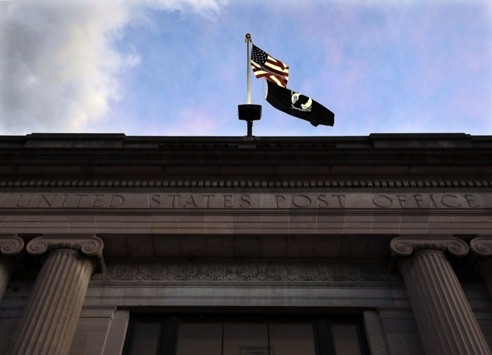 <strong>An American flag flies over the main U.S. Post Office branch in Downtown Memphis Aug. 20, 2020.</strong> (Patrick Lantrip/Daily Memphian)