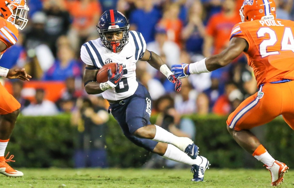 <strong>Former running back Jaylen Walton (6) rushes for yardage during the first half of an NCAA college football game against Florida Saturday, Oct. 3, 2015, in Gainesville, Florida.</strong> (AP Photo/Gary McCullough)