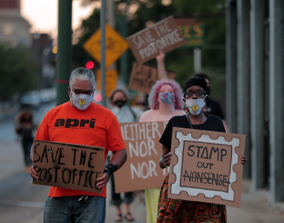<strong>Regina Clarke (right) leads a march down G.E. Patterson Aug. 20, 2020 protesting the cuts to the post office before the 2020 presidential election.</strong> (Patrick Lantrip/Daily Memphian)