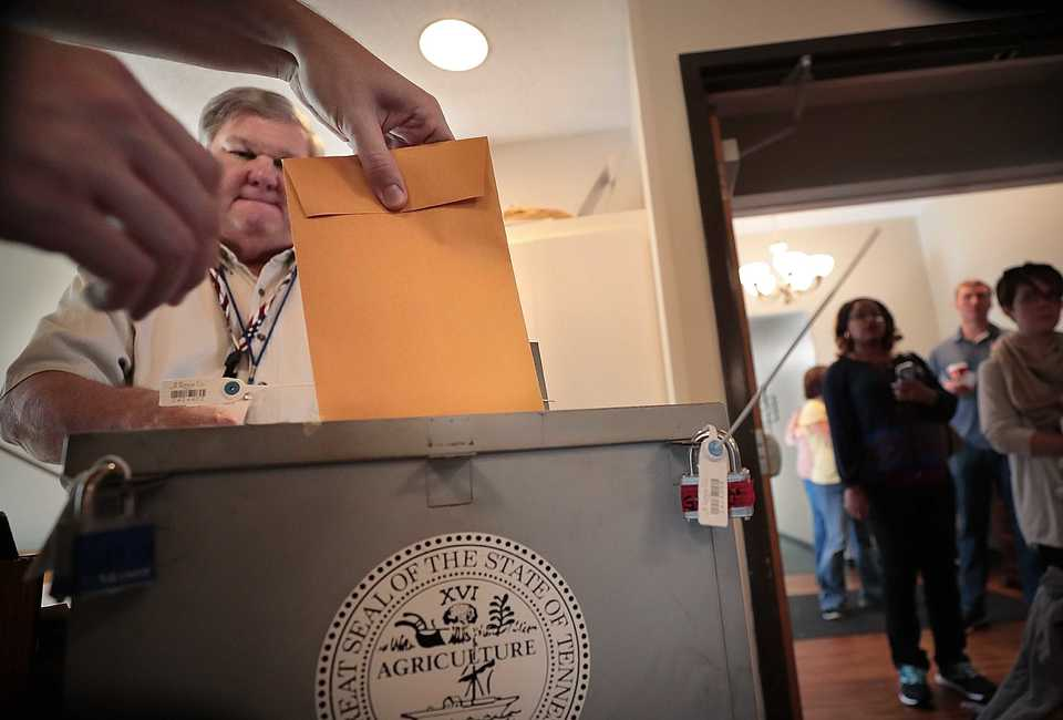 <strong>Chase Wyatt casts a paper vote under the watchful eye of election officer Lenard Grice at the Riveroaks Reformed Presbyterian Church polling location in Germantown on Nov. 6, 2018.</strong> (Jim Weber/Daily Memphian)