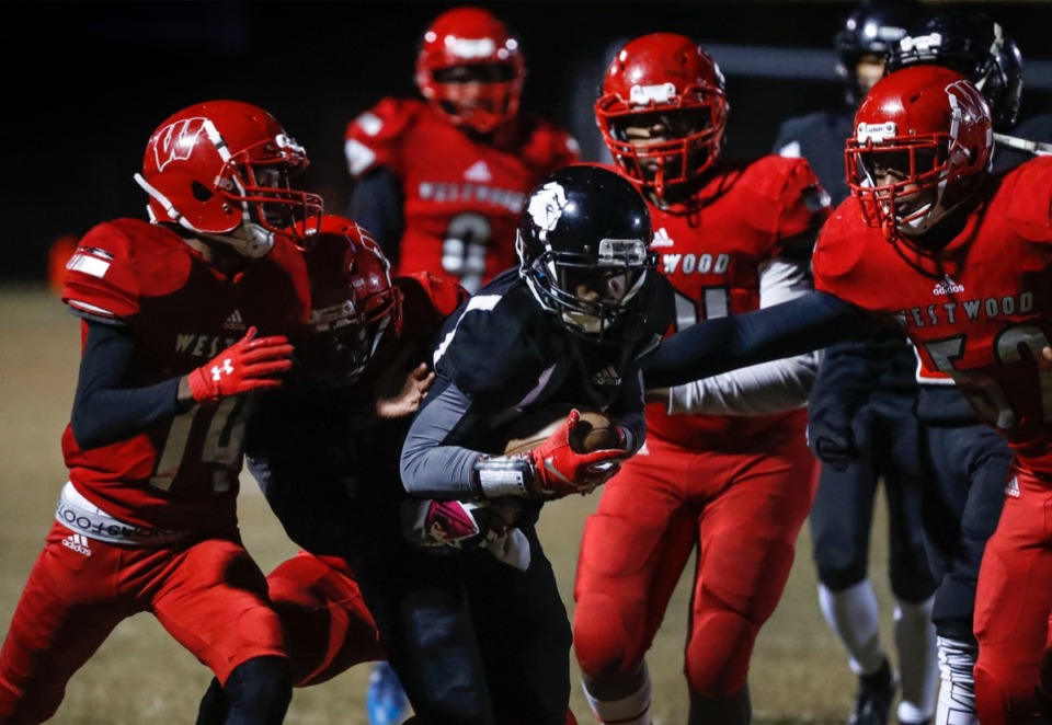 <strong>Middle College punter returner Joyner Stephens (middle) runs for positive yards against the Westwood defense during action in their high school football game Thursday, Oct. 31, 2019.</strong> (Mark Weber/Daily Memphian file)