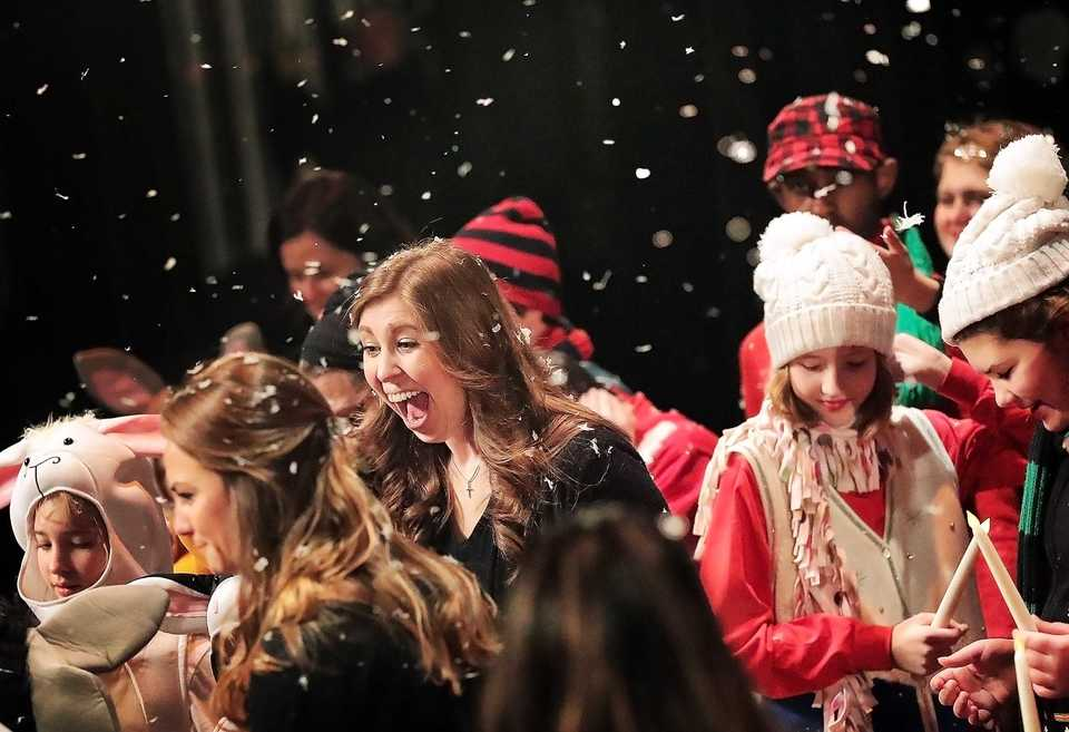 <strong>Students and instructors from the Madonna Learning Center get a snowy treat at the end of their annual Christmas show on Dec. 11, 2018, at the Germantown Performing Arts Center. The Madonna Learning Center is a nonprofit school and adult training facility for kids and adults with intellectual disabilities.</strong> (Jim Weber/Daily Memphian)