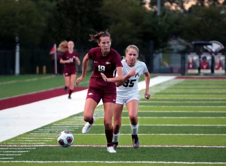 <strong>Evangelical Christian School's Delaney Stookey (19) fights for a loose ball against Arlington High School's Jessica Richardson (35) during an Aug. 25 home game.</strong> (Patrick Lantrip/Daily Memphian)