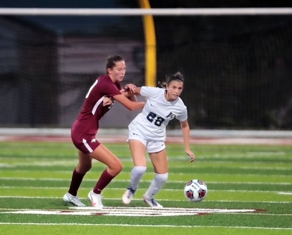 <strong>Arlington High School's Aspen Bailey (28) fights for the ball during an Aug. 25, 2020, game at Evangelical Christian School.</strong> (Patrick Lantrip/Daily Memphian)