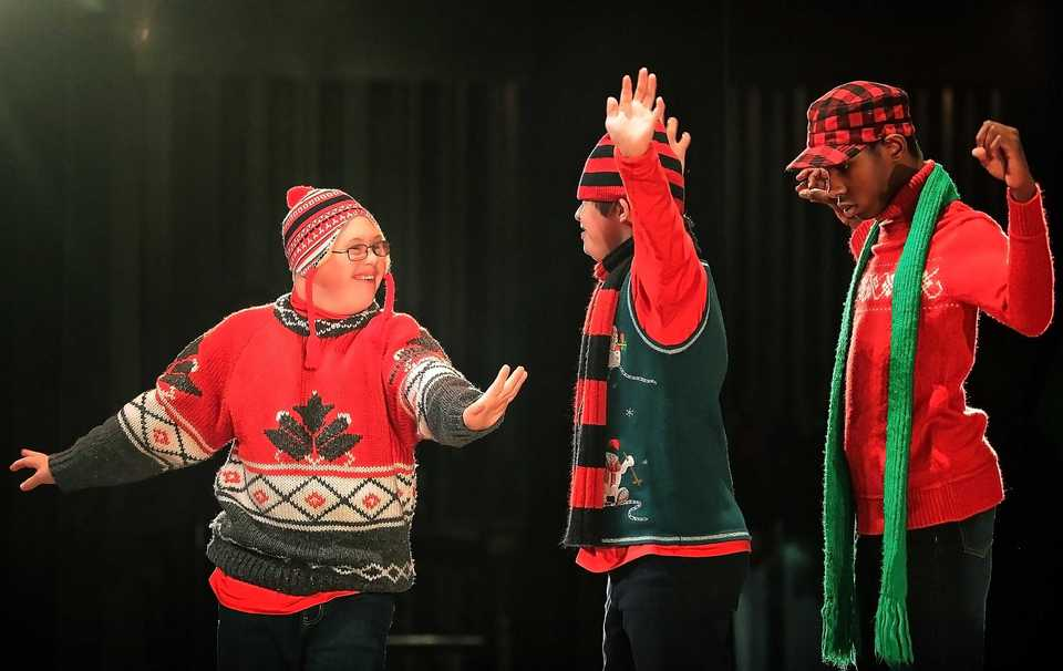 <strong>Dylan Horne (left) checks to make sure he is in step as students and instructors from the Madonna Learning Center dance their way through the school's annual Christmas show on Dec. 11, 2018, at the Germantown Performing Arts Center. The Madonna Learning Center is a nonprofit school and adult training facility for kids and adults with intellectual disabilities.</strong> (Jim Weber/Daily Memphian)
