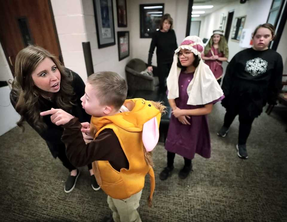 <strong>Students from the Madonna Learning Center get a high-fives and congratulations from their teachers after the annual Christmas show on Dec. 11, 2018, at the Germantown Performing Arts Center. The Madonna Learning Center is a nonprofit school and adult training facility for kids and adults with intellectual disabilities.</strong> (Jim Weber/Daily Memphian)