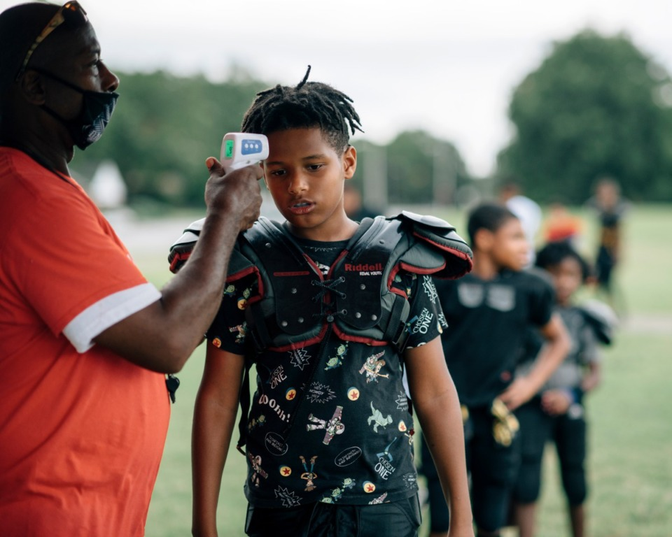 <strong>Da&rsquo;Ryan Nebills (right) gets his temperature checked before heading out onto the field for practice.</strong> (Houston Cofield/Special to The Daily Memphian)