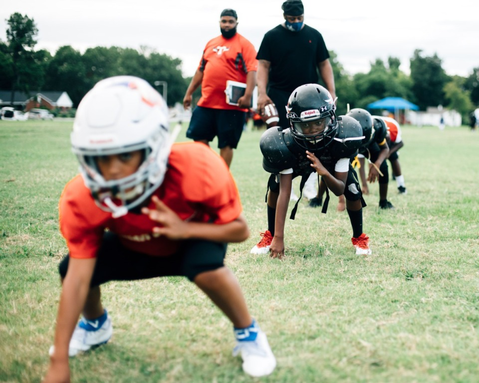 <strong>Youths line up in offensive poses at Godwin Park during a flag football practice.</strong> (Houston Cofield/Special to The Daily Memphian)