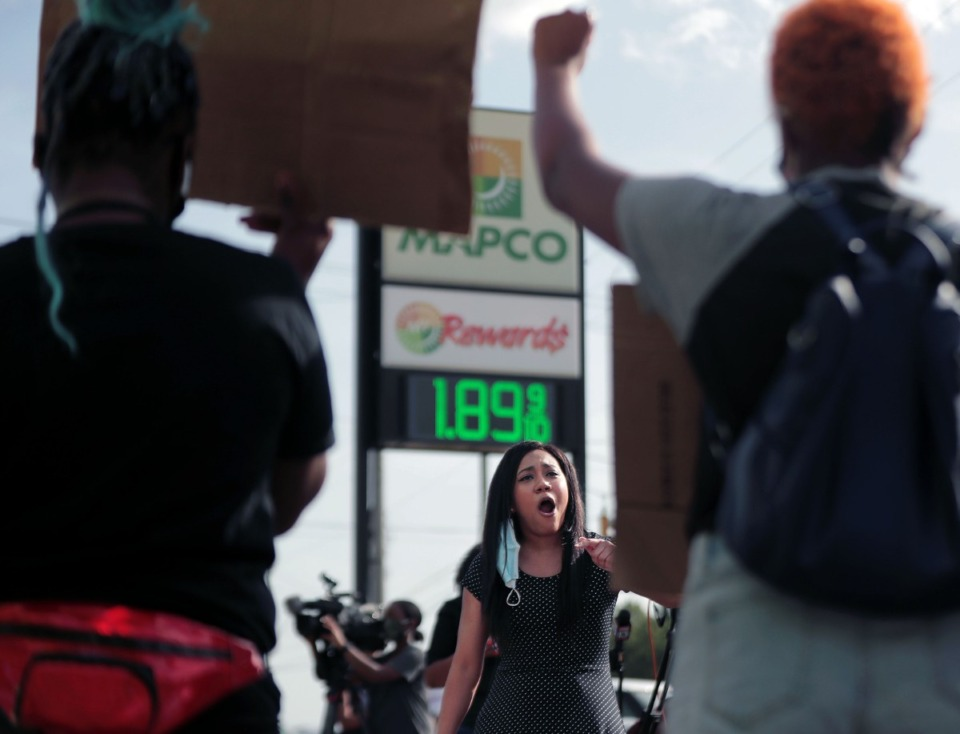 <strong>Rachel Black addresses the crowd during a protest on Wednesday, Aug. 26, at a South Memphis Mapco where U.S. Marshals shot a 17-year-old a day earlier in a case of mistaken identity.</strong> (Patrick Lantrip/Daily Memphian)