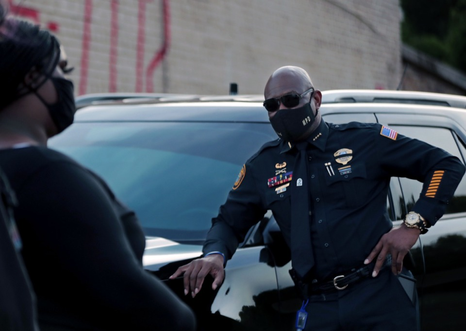 <strong>A Memphis Police officer listens to protestors during an Aug.26, 2020, protest held at the South Memphis Mapco where U.S. Marshals shot a 16-year-old last night in a case of mistaken identity.</strong> (Patrick Lantrip/Daily Memphian)