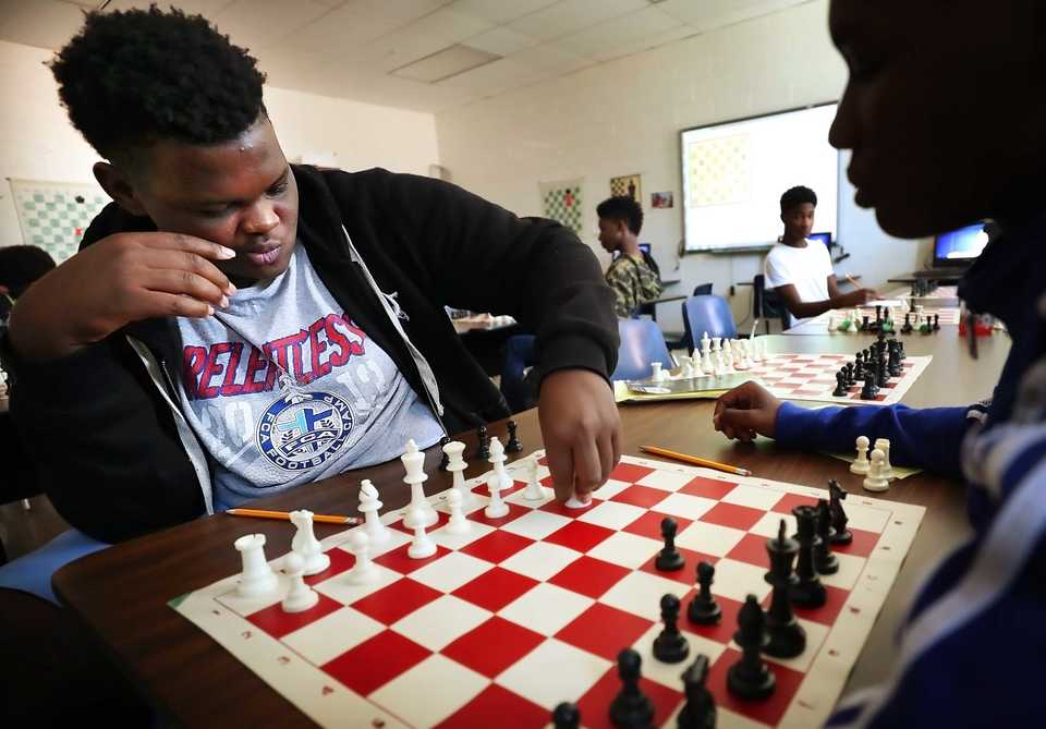 <strong>Sophomore Jalen Royal (left) ponders a move against Kylan Richardson in Kuwane Turner's chess class at Douglass High School on Aug. 27. The class helps teach students good sportsmanship as well as critical and strategic thinking</strong>. (Jim Weber/Daily Memphian)