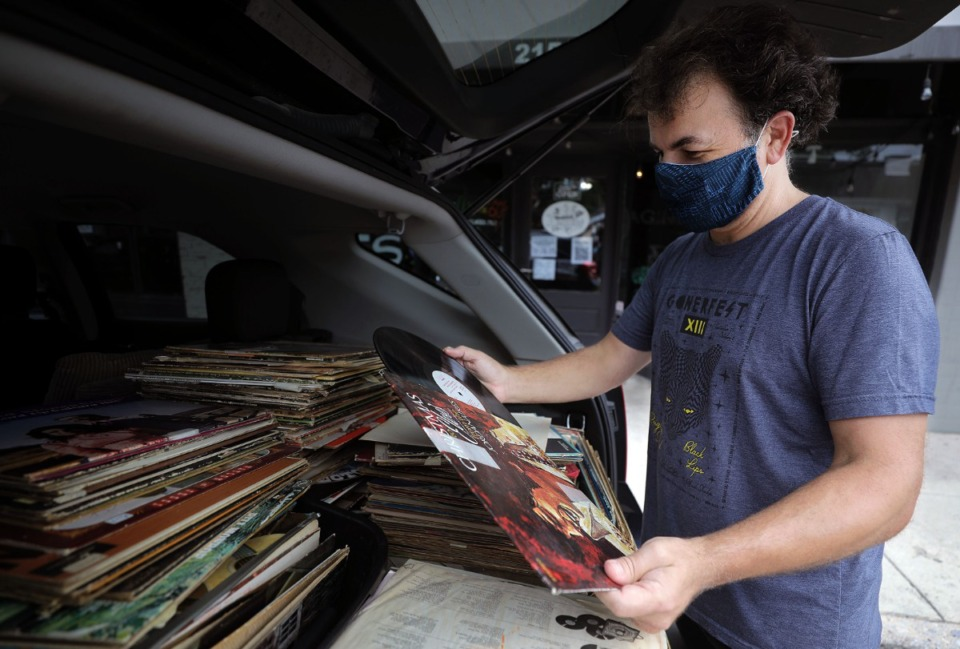 <strong>Goner Records owner Zac Ives goes through an old collection of vinyl records a couple from Jonesboro came across while cleaning out a grandparent's house Aug. 27, 2020.</strong> (Patrick Lantrip/Daily Memphian)