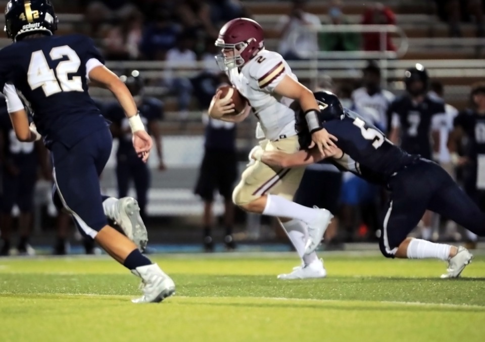 <strong>ECS quarterback Jacob Hatcher rushes the ball during an Aug. 27, 2020, game at Arlington.</strong> (Patrick Lantrip/Daily Memphian)