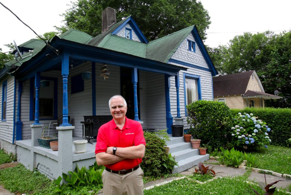 <strong>Stoy Bailey stands in front of a Victorian cottage, one of the first houses built in the first black subdivision in the city of Memphis. The house was built around 1900, and while Orange Mound was an older area, it was classified as part of the county when the North Annesdale subdivision was built. Bailey died July 4 at age 86.</strong> (Lance Murphey/Daily Memphian file)