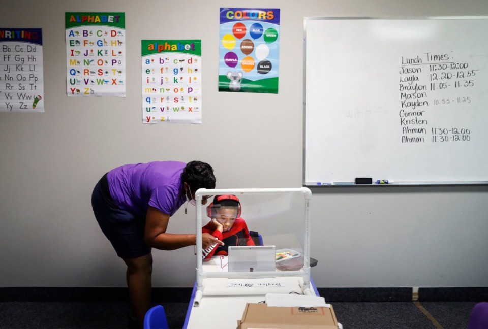 <strong>New Life Learning Academy volunteer Brittany Anderson works with her six-year-old son Braylon Jeffries on his classwork on Monday, Aug. 31, 2020. Braylon is a first</strong><strong>&nbsp;a grader at Germanshire Elementary. </strong>(Mark Weber/Daily Memphian)