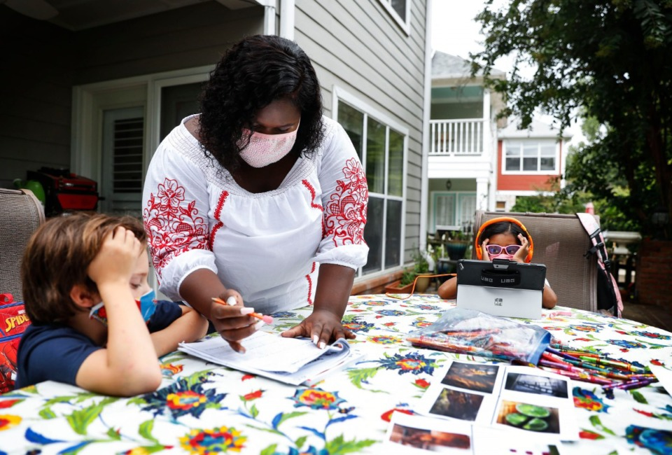<strong>Homeschool teacher Brie Smith (middle) works with students Beck Whitaker, 7, (left) and Izabelle Chinnicah, 7, (right) on Monday, Aug. 31, 2020. </strong>(Mark Weber/Daily Memphian)