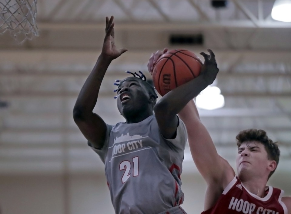 <strong>Hoop City guard Daveonne Warfield (21) gets the ball stripped by forward Zander Yates (25) during a Aug. 29, 2020 showcase game at St. Benedict.</strong> (Patrick Lantrip/Daily Memphian)
