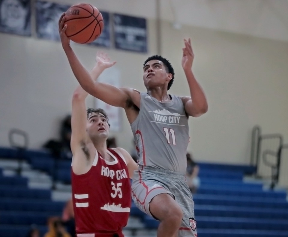 <strong>Hoop City guard Reese McMullen (11) lays the ball up during an Aug. 29, 2020 showcase game at St. Benedict.</strong> (Patrick Lantrip/Daily Memphian)