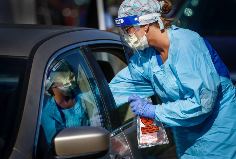 <strong>Registered nurse Holly Cote administers COVID-19 swabs during a drive-thru testing site Thursday, June 18, 2020 at Baptist Memorial Hospital-Memphis.</strong> (Mark Weber/Daily Memphian)