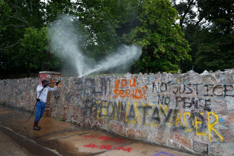"<strong/>Graceland maintenance employee Grant Williams pressure washes the stone wall outside Graceland on Tuesday, Sept. 1, after protesters spray painted the wall overnight. (Mark Weber/Daily Memphian)""><figcaption> </figcaption></figure> </div> <div class="