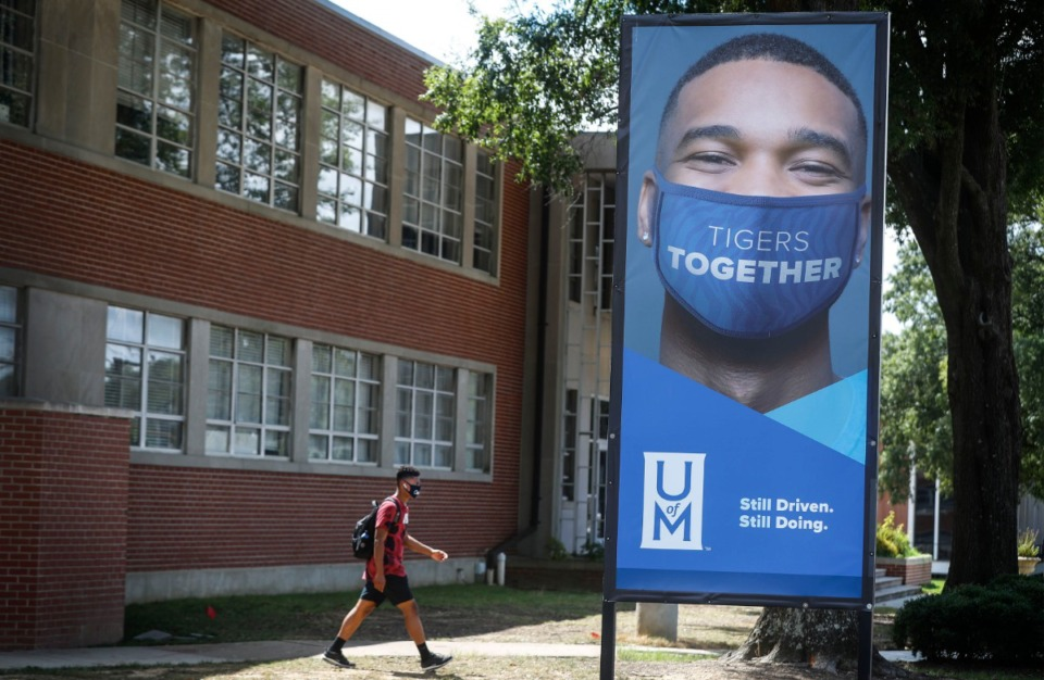 <strong>A student walks to class on the campus of the University of Memphis on Tuesday, Aug. 25. The university is considering bringing more students back to campus as early as Sept. 14, according to an email faculty received Monday.</strong> (Mark Weber/Daily Memphian)