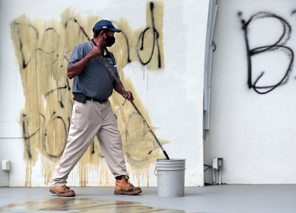 <strong>City employees work to remove the graffiti from the Levitt Shell Sept. 1, 2020.</strong> (Patrick Lantrip/Daily Memphian)