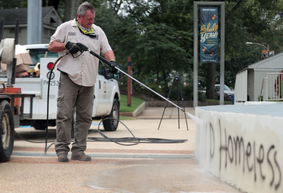 <strong>A city worker uses a pressure washer to remove graffiti from the Levitt Shell Sept. 1, 2020.</strong> (Patrick Lantrip/Daily Memphian)