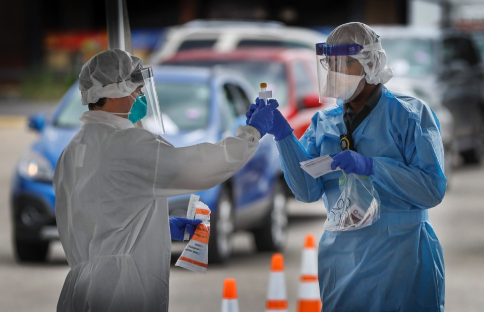 <strong>Christ Community Health Center medical staff collect nasal swabs as hundreds of Memphians line up for COVID-19 testing at their site in Hickory Hill on Tuesday, May 19, 2020</strong>. (Mark Weber/Daily Memphian)