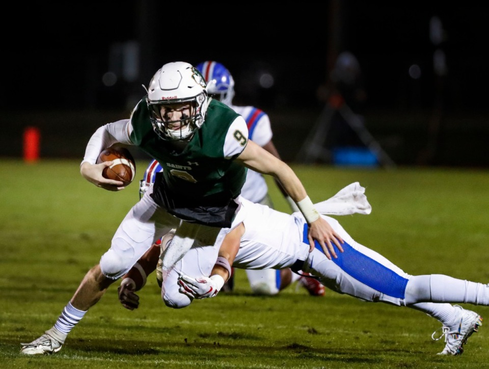<strong>Briarcrest quarterback Michael Dallas fights for a first down against the MUS defense during action in their high school football game Friday, Nov. 1, 2019.</strong> (Mark Weber/Daily Memphian file)