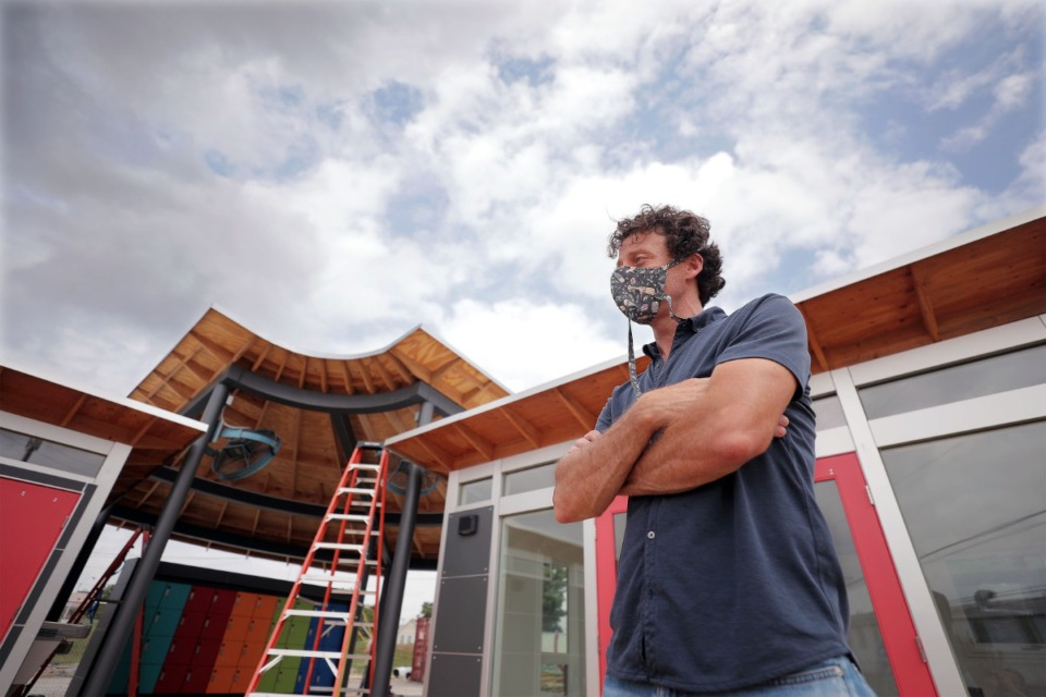 <strong>Jarad Bingham stands in front of the new Hub Hospitality complex at 590 Washington Ave. Sept. 1, 2020.</strong> (Patrick Lantrip/Daily Memphian)