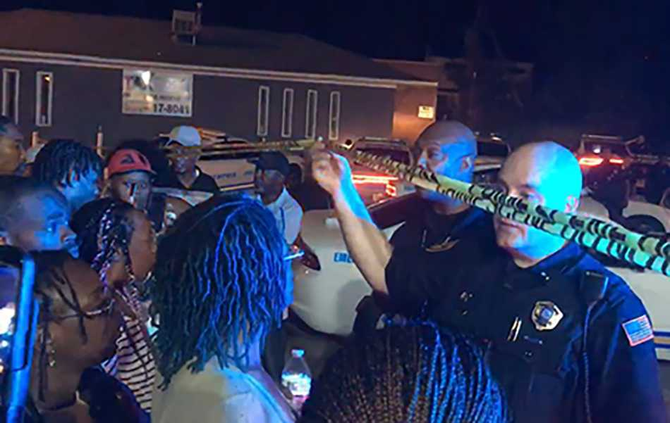 <span><strong>Janice Banks (center) demands answers from Memphis police officers after her son, Martavious Banks was shot by an officer on Sept. 17 &nbsp;in South Memphis.</strong> (Yolanda Jones/Daily Memphian)</span>